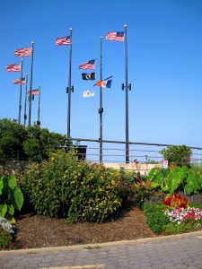 A view of the flags on the boardwalk from the garden below