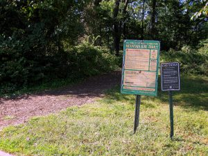 Wolfe's Pond Park. Signs inform guests to the park of the tick hazard. Image Credit- Staten Islander News Organization