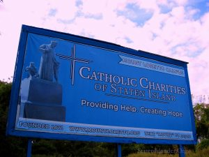 Catholic Charities of Staten Island Signage On Hylan Along Mount Loretto Woodlands. Image Credit - StatenIslander.Org