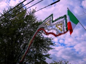 Red, White, and Green Streamer and Italian Flag Decorate Mount Loretto Entrance. Image Credit - Staten Islander News Org