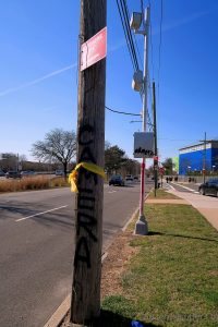 Islanders spray painted the word CAMERA on a utility pole. Someone else painted it in RED on the camera pole. And, still others fixed yellow ribbons.