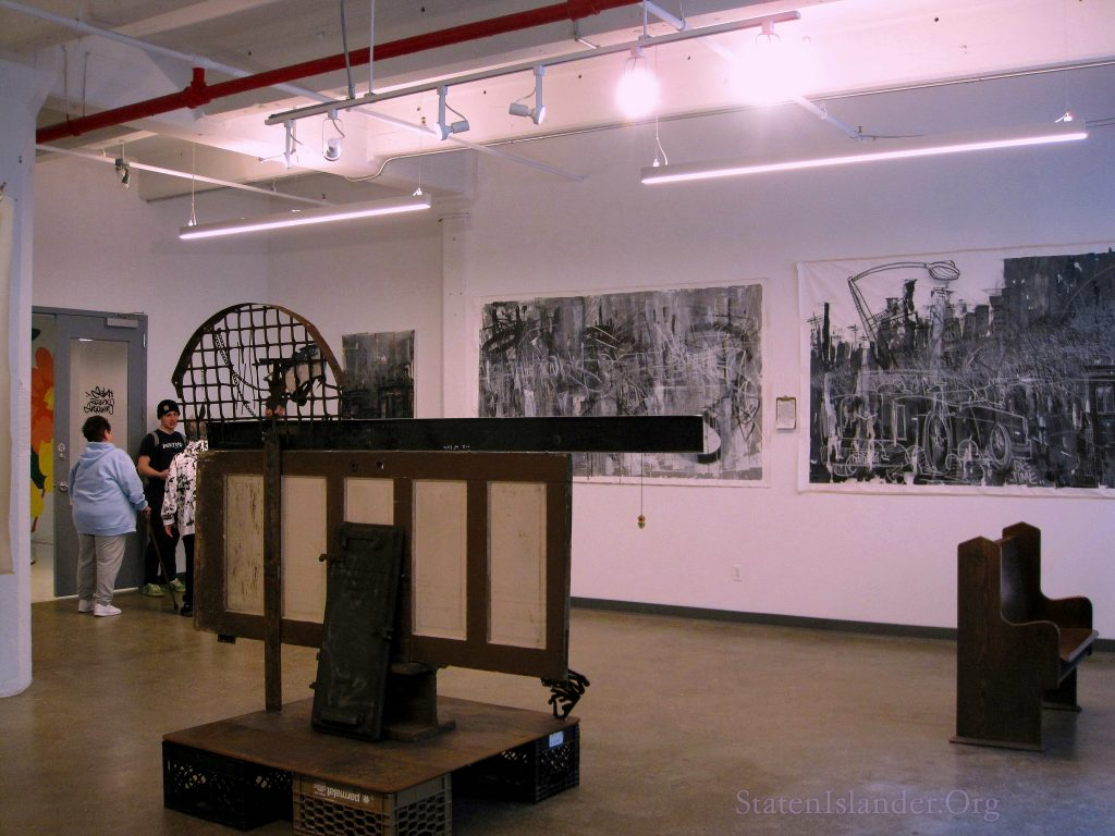 The gallery space with guests.
