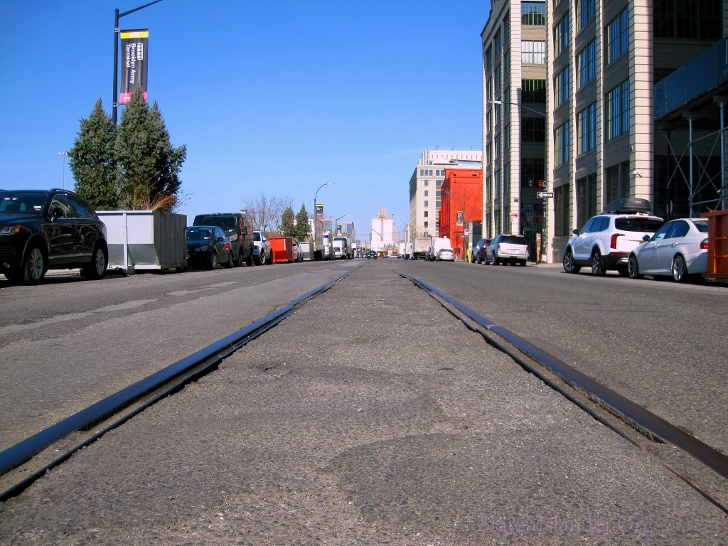Tracks Partially Covered with Asphalt.