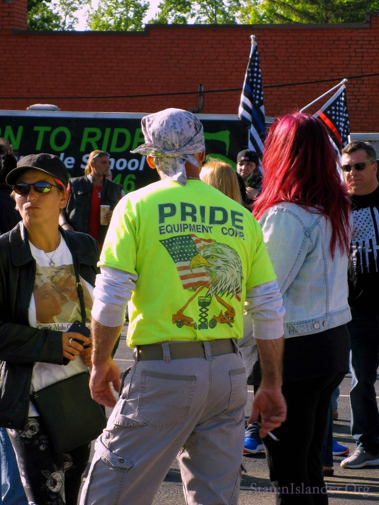 Attendee of Annadale Save Staten Island Small Business Rally Wearing a Pride Equipment Shirt