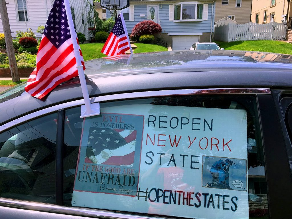 Car At Travis Back2Work Rally with American Flags and Reopen New York State. Image Credit- Mary Ellen