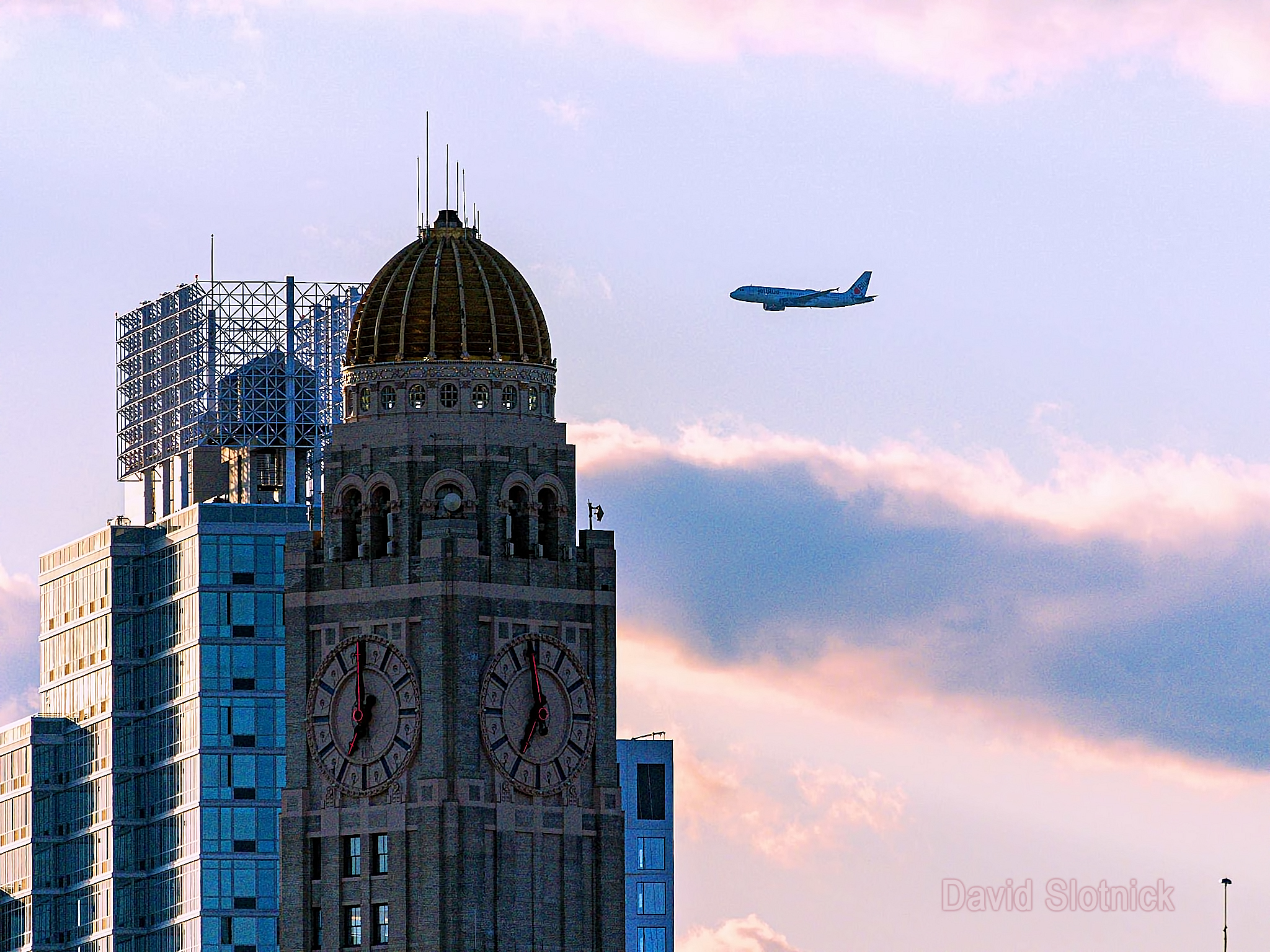 JetBlue Tribute Flyover Passing Williamsburg Bank Building In Brooklyn. Image Credit- David Slotnick