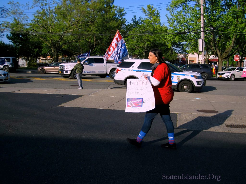 Mary Ellen Holds A Freedom Friday Sign As She Walks Across The Lot At The Rally To Save Staten Island Small Businesses