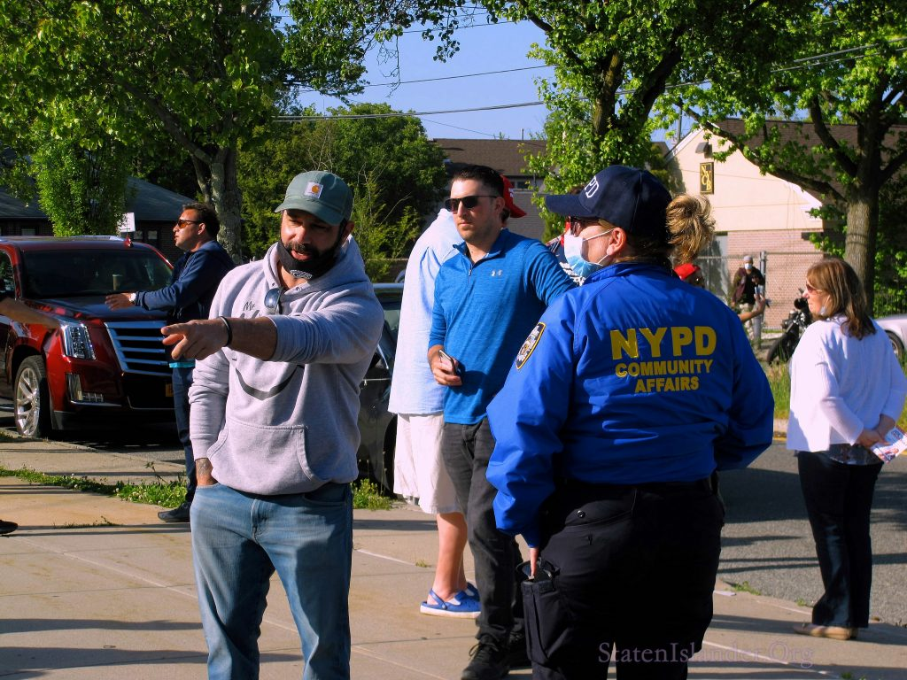 NYPD Community Affairs Officer Speaks With Rally Particpant