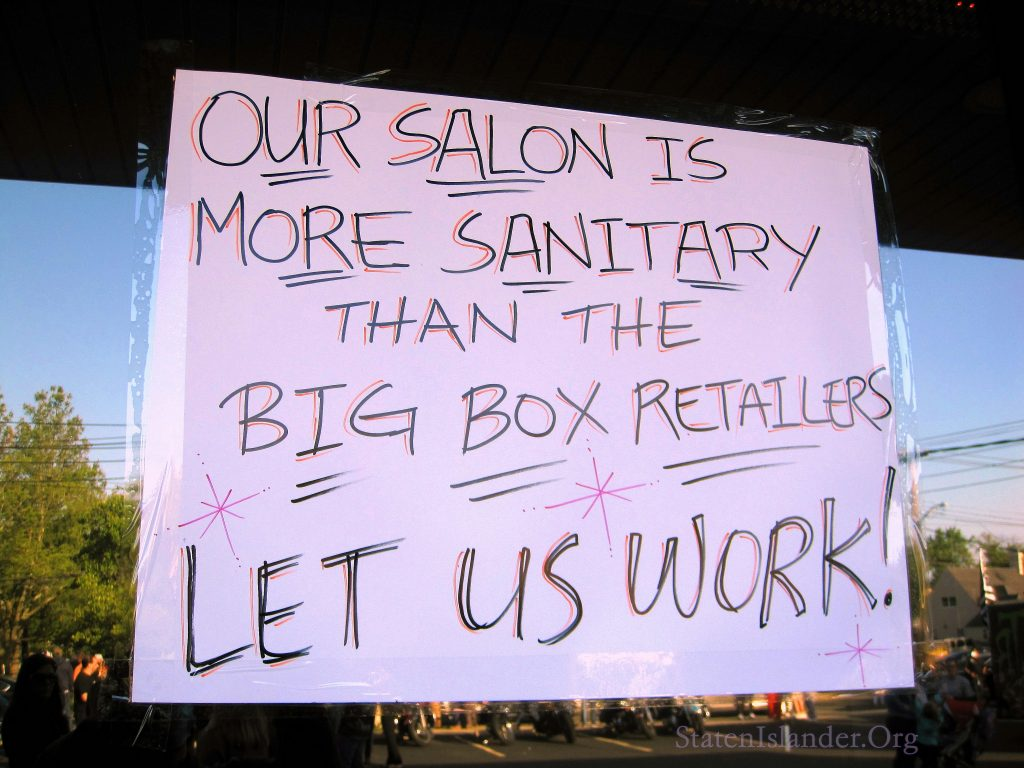 Our Salon Is More Sanitary Than The Big Box Retailers, Let Us Work, Declares The Sign In The Window Of Shades Of Color, A Small Business Affected By The Shutdown In New York