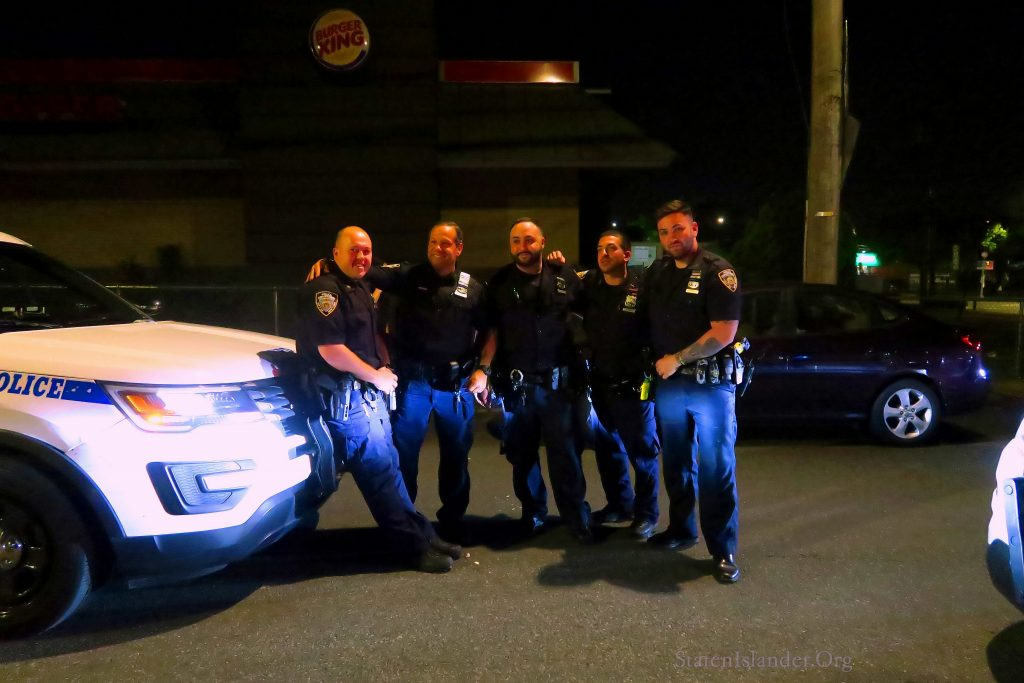 Police Officers From the 121 Come To The Aid Of a Cat Stuck Under The Hood Of A Parked Car In Port Richmond Center