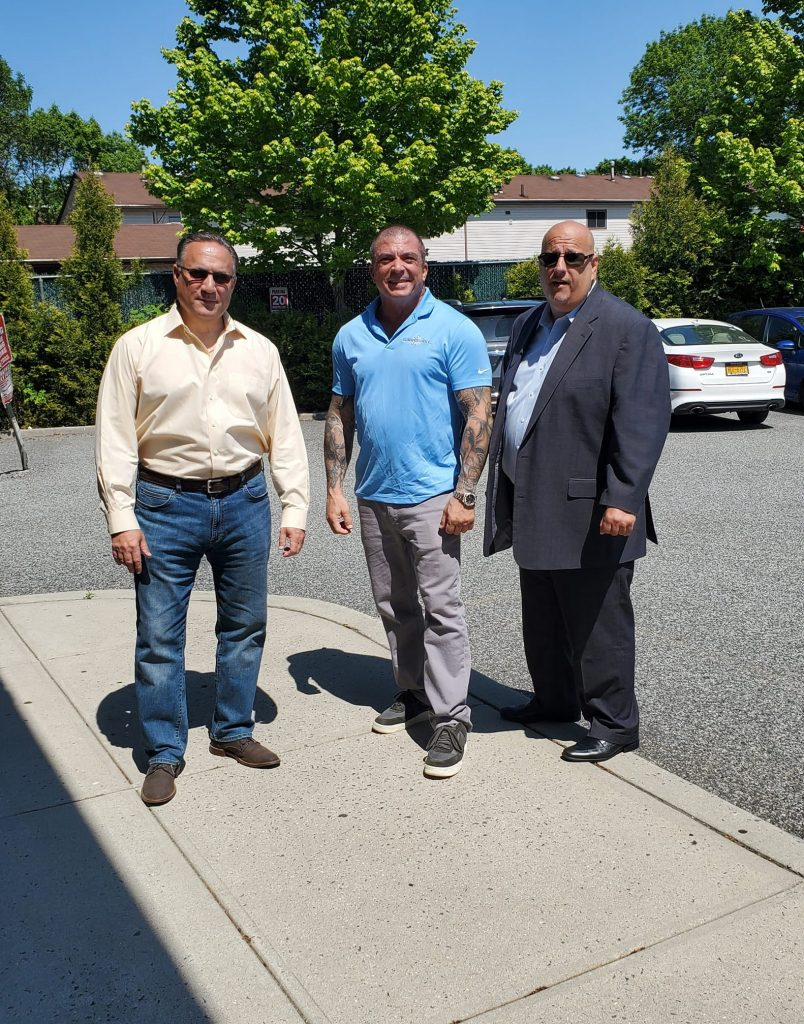 Lou Gelermino and Mark Fonte, attorneys, with Bobby Catone of Sunbelievable Tanning