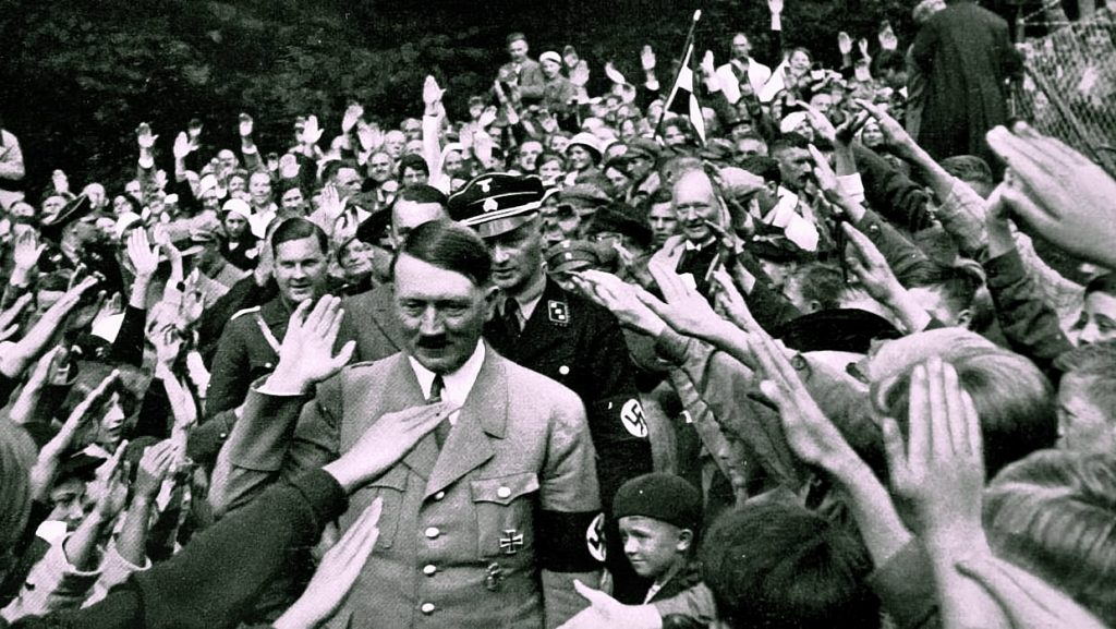 Original Picture of Hitler Photoshopped To Show Him Holding a Bible Like President Trump